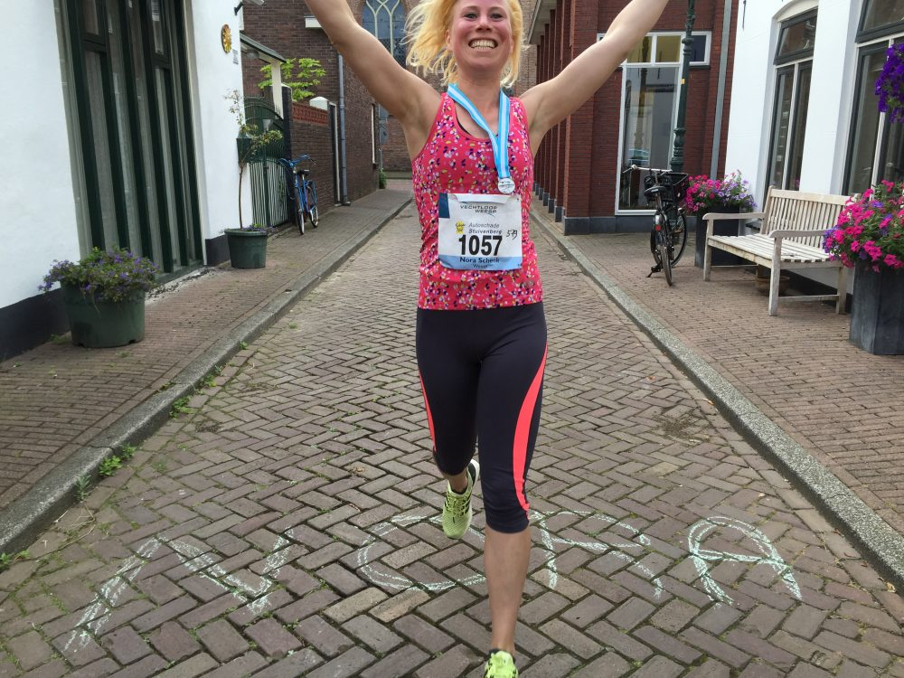 Vechtloop door de middenstraat Weesp